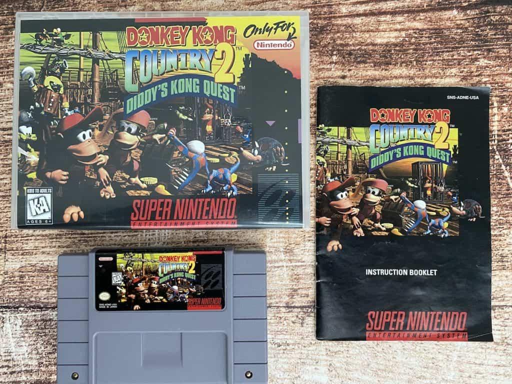 Donkey Kong Country 2 cartridge, box, and manual