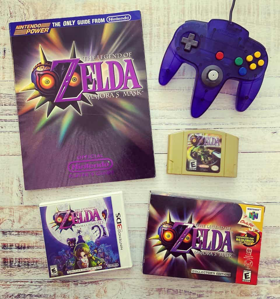 Zelda Majora's Mask collector's edition cart, box, player's guide, 3DS edition, and grape purple funtastic controller