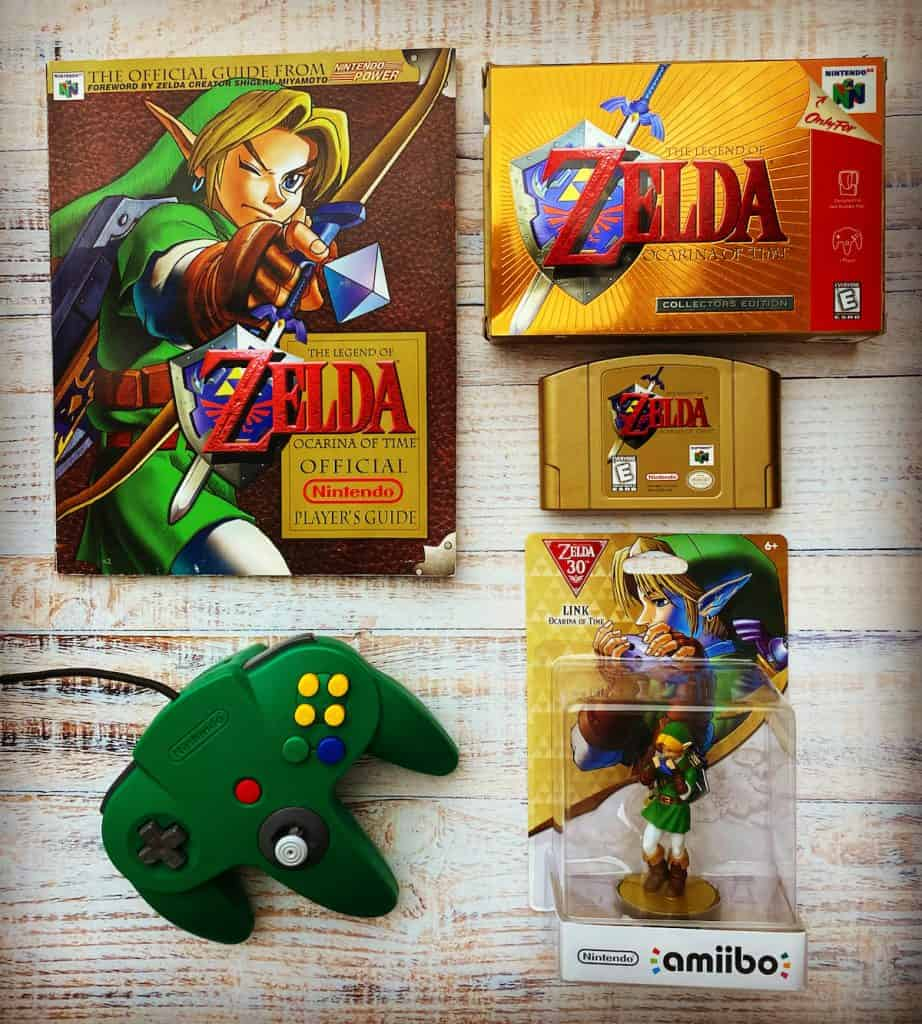 Zelda Ocarina of Time Collector's Edition box, cart, player's guide, amiibo, and green N64 controller