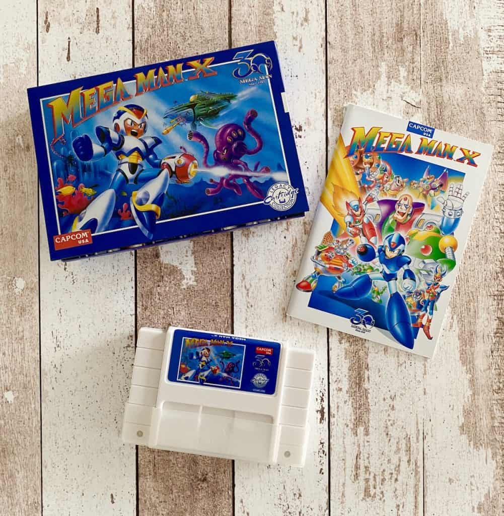 Mega Man X iam8bit Anniversary Edition box, manual, and cart