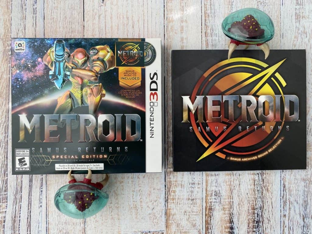 Metroid Samus Returns Special Edition box, soundtrack, and metroid figures