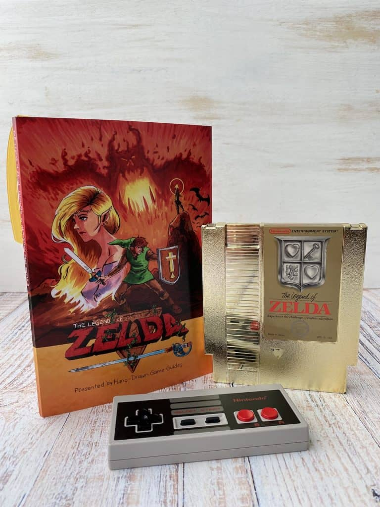 Zelda Hand Drawn Game Guide, NES cart, and NES controller
