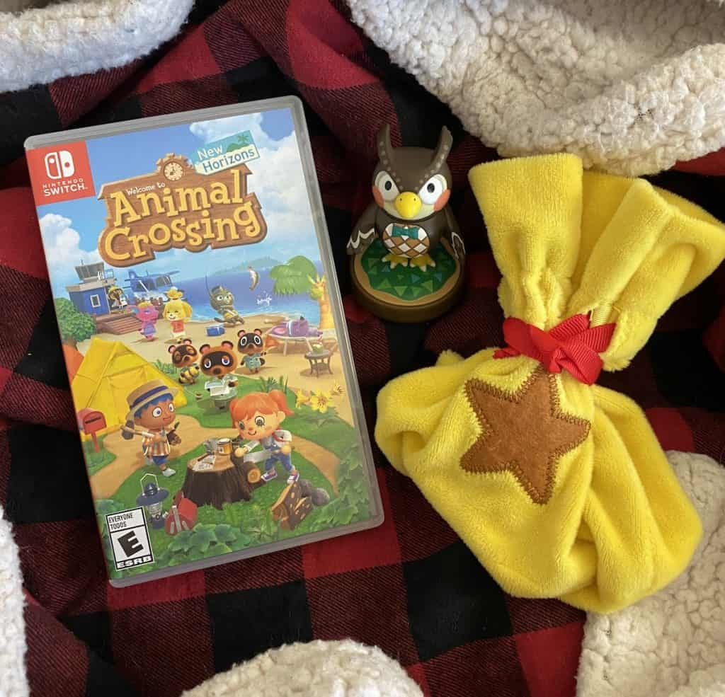 Animal Crossing New Horizons on Switch, bell bag, and Blathers amiibo