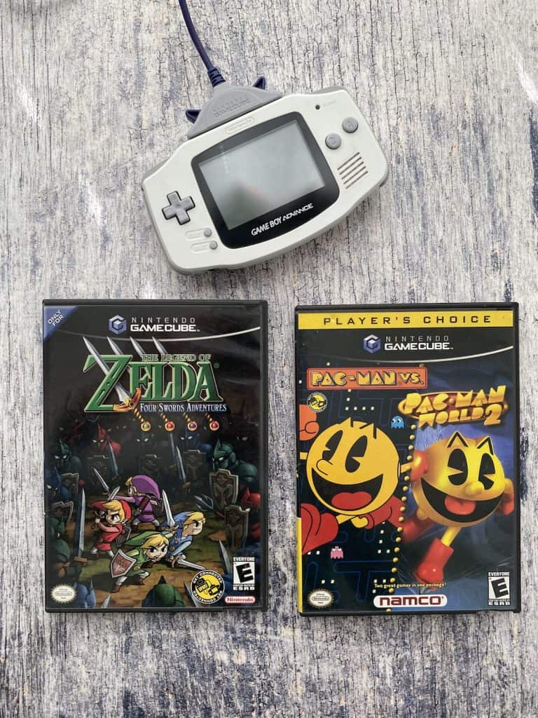 Game Boy Advance to GameCube connector with Game Boy Advance, Zelda Four Swords Adventures, and Pac Man Vs.