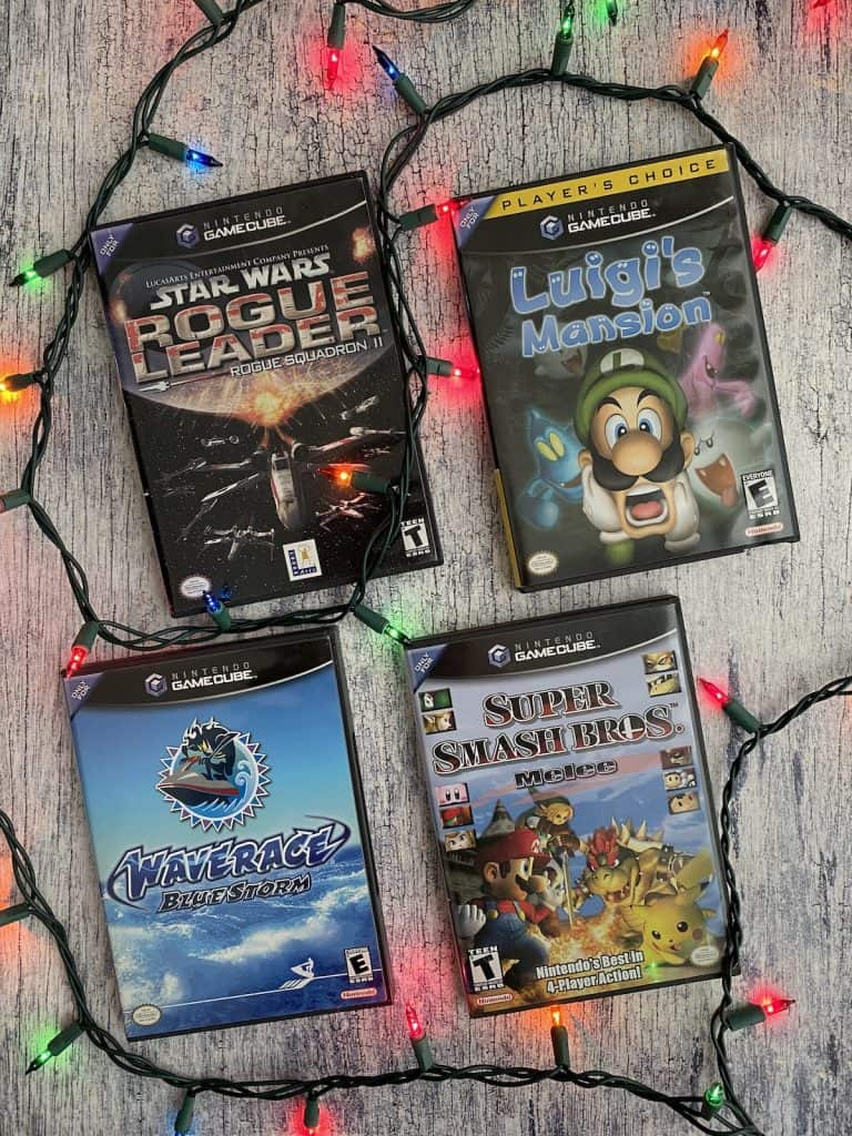 Star Wars Rogue Leader, Luigi's Mansion, Wave Race Blue Storm, and Smash Bros Melee surrounded by Christmas lights