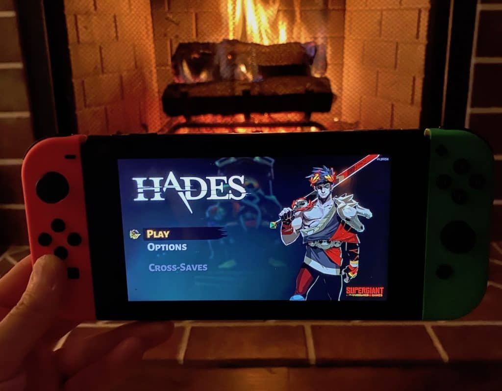 Hades on Nintendo Switch in front of a fireplace