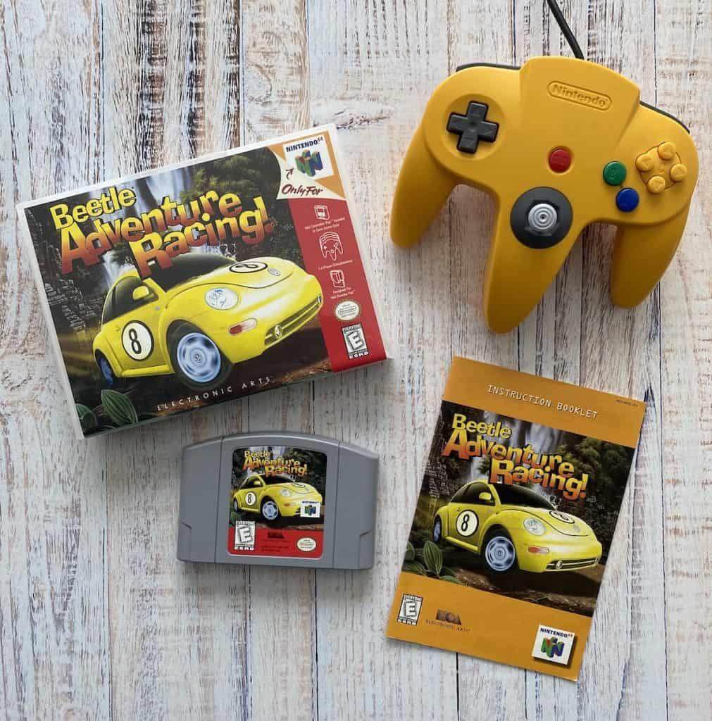 Beetle Adventure Racing cart, box art, manual, and yellow N64 controller