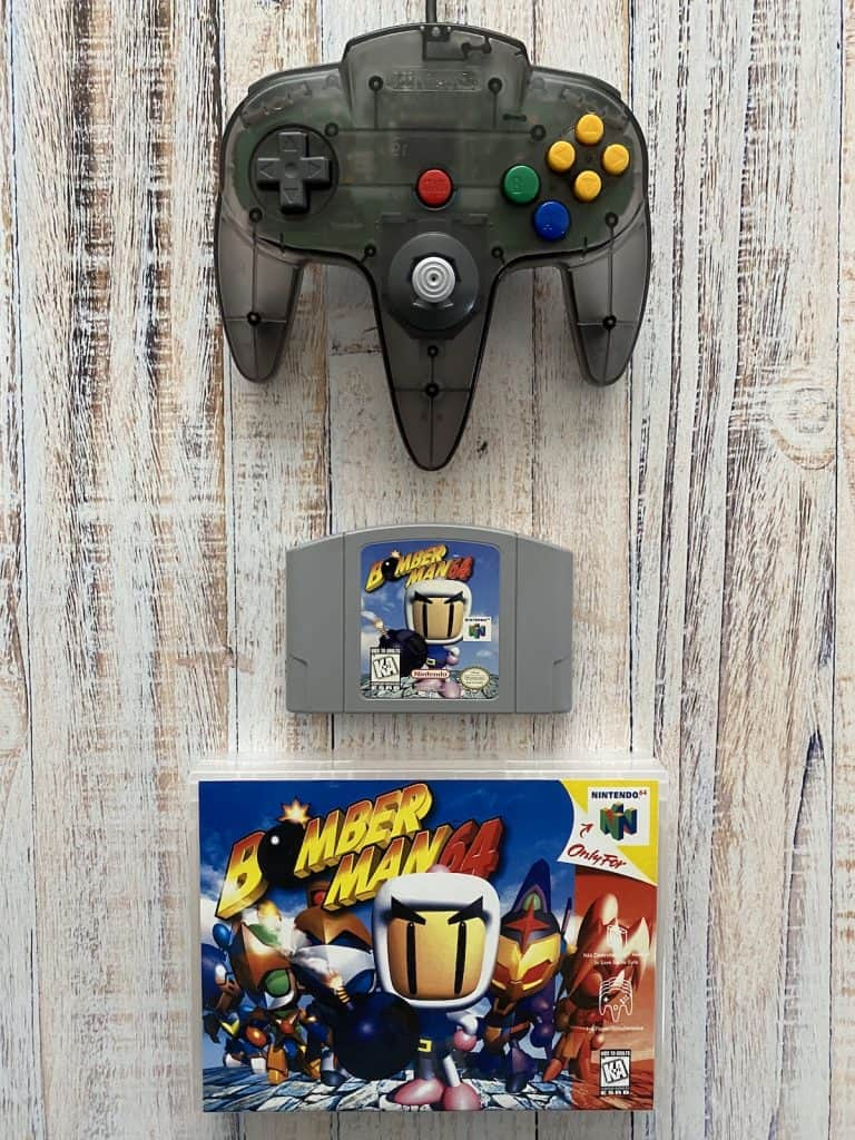 Bomberman 64 cart, box art, and smoke funtastic controller