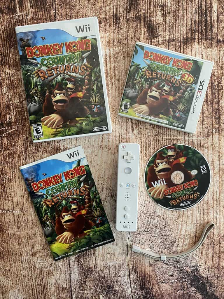 Donkey Kong Country Returns Wii box, disc, manual, Wii remote, and 3DS version of game
