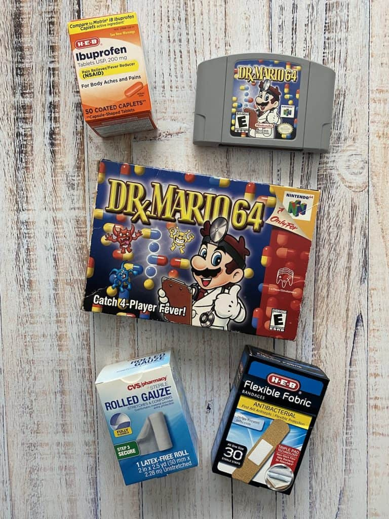 Dr. Mario 64 cart and box, with band-aids, gauze, and ibuprofen