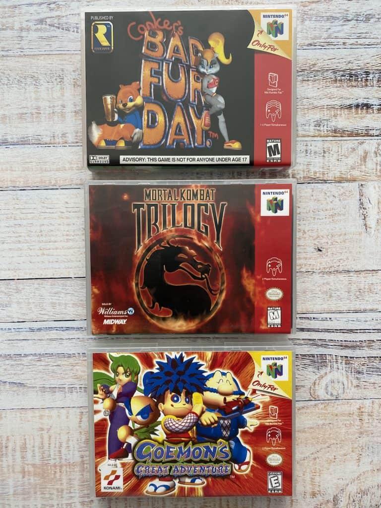 Conker's Bad Fur Day, Mortal Kombat Trilogy, and Goemon's Great Adventure box art