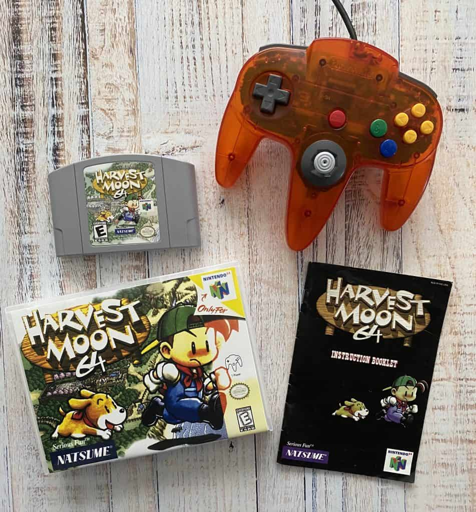 Harvest Moon 64 cart, box, manual, and fire orange controller.