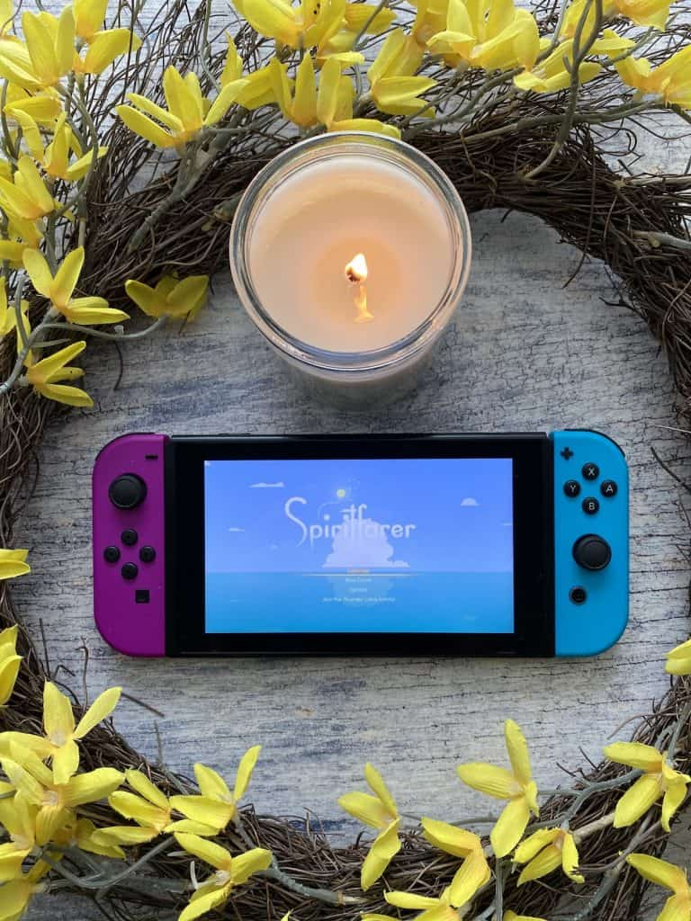 Spiritfarer for Switch with a candle and yellow wreath