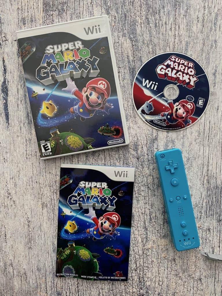 Super Mario Galaxy box, manual, disc. and blue wii remote