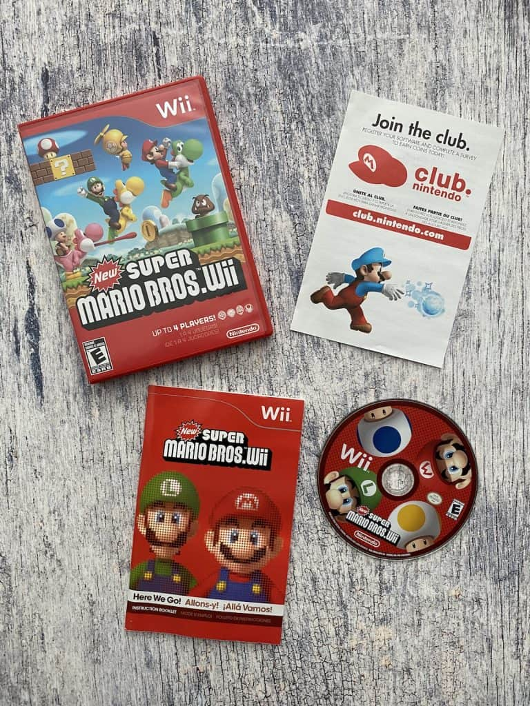 New Super Mario Bros Wii case, disc, and manual