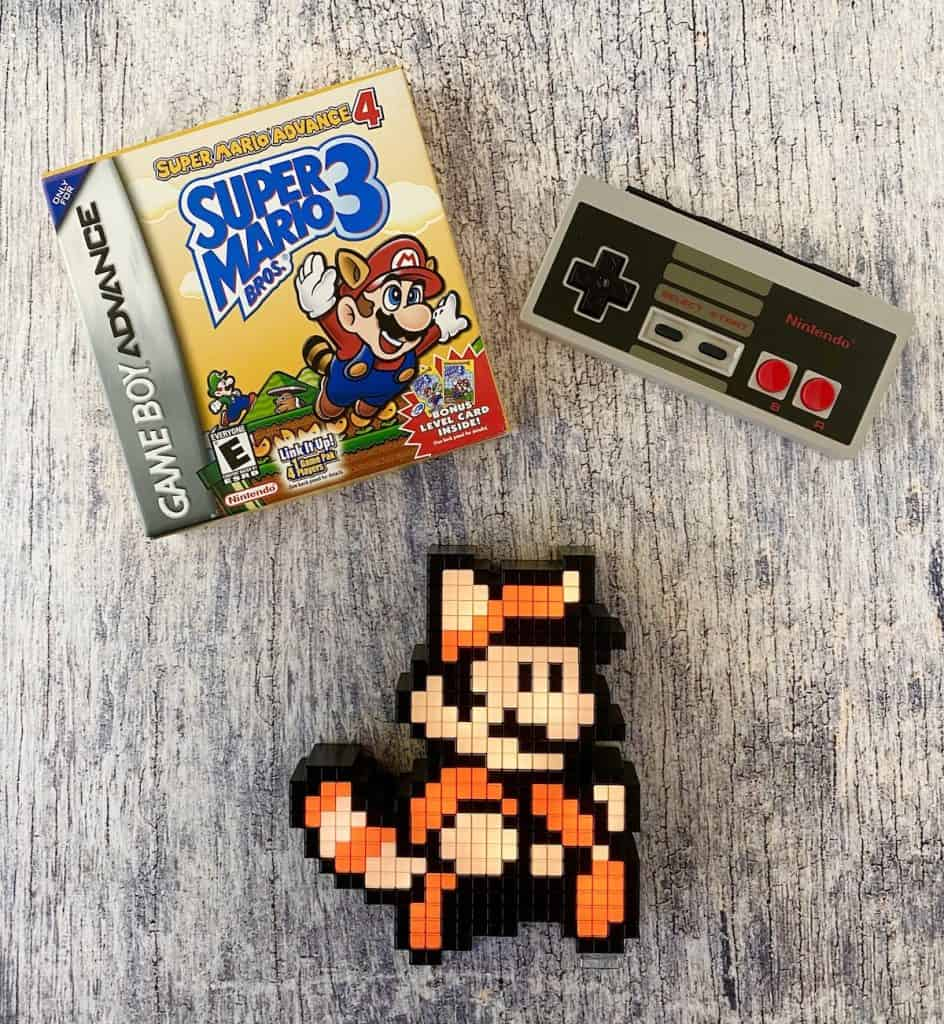 Super Mario Advance 4, Racoon Mario amiibo, and NES controller