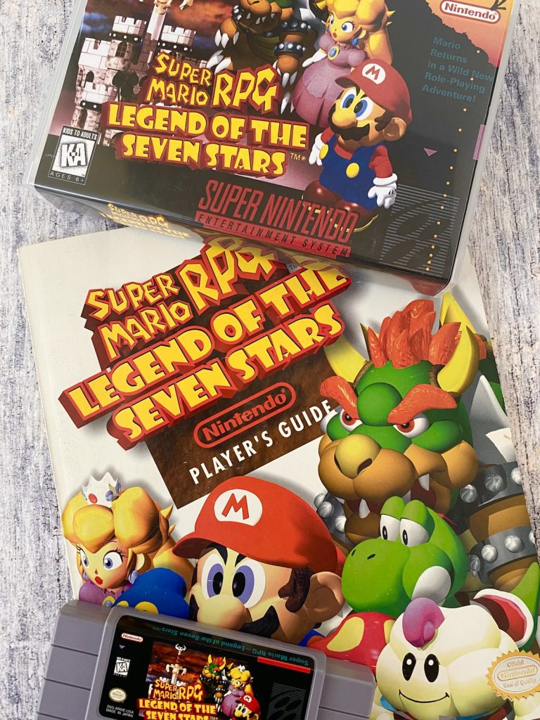 Super Mario RPG box, cart, and Nintendo Power player's guide