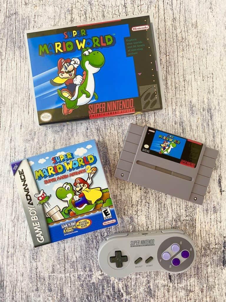 Super Mario World box and cart, Mario Advance 2 box, and SNES controller