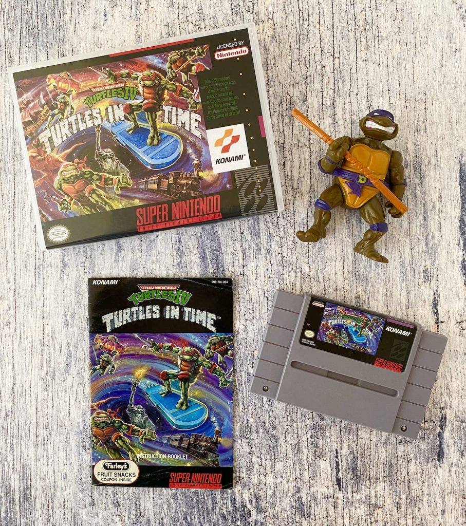 Turtles in Time box, manual, cart, and Donatello figure