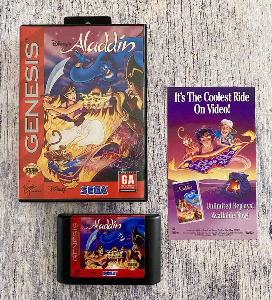 Aladdin Sega Genesis box, cart, and advertisement insert