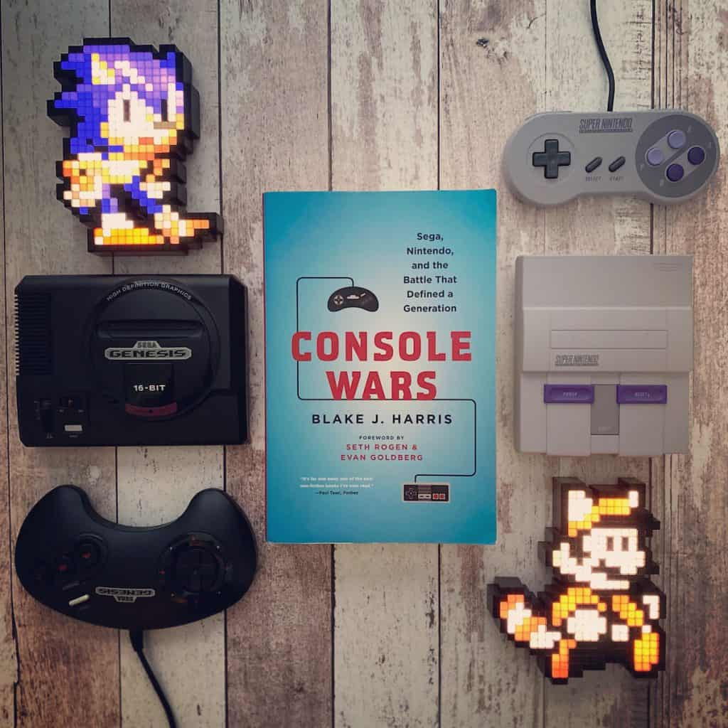 Console Wars book with Sega Genesis and SNES mini, and Mario and Sonic pixel pals
