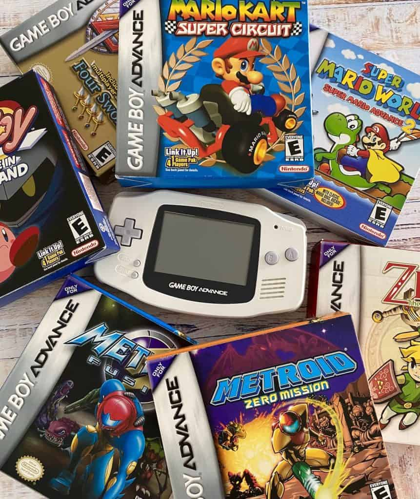Arctic white Game Boy Advance system surrounded by CIB games