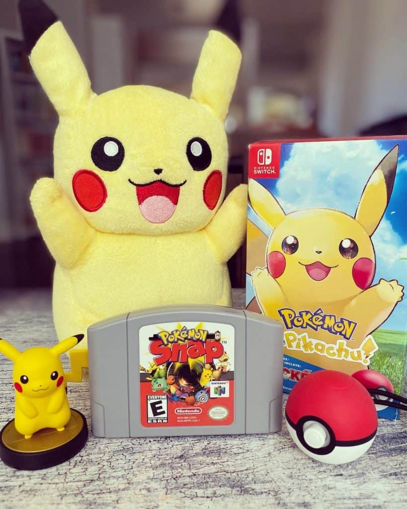 Pokemon Let's Go Pikachu box, Pikachu stuffy, Pikachu amiibo, Pokeball Plus, and Pokemon Snap