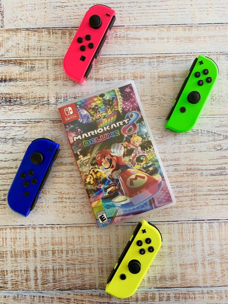 Mario Kart 8 Deluxe for Switch with pink, green, blue, and yellow joy cons