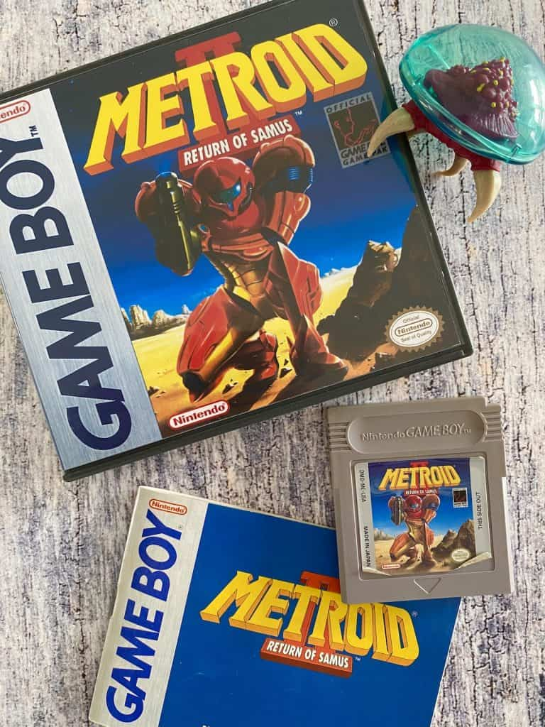 Metroid II Return of Samus on Game Boy box, cart, manual, and Metroid figure