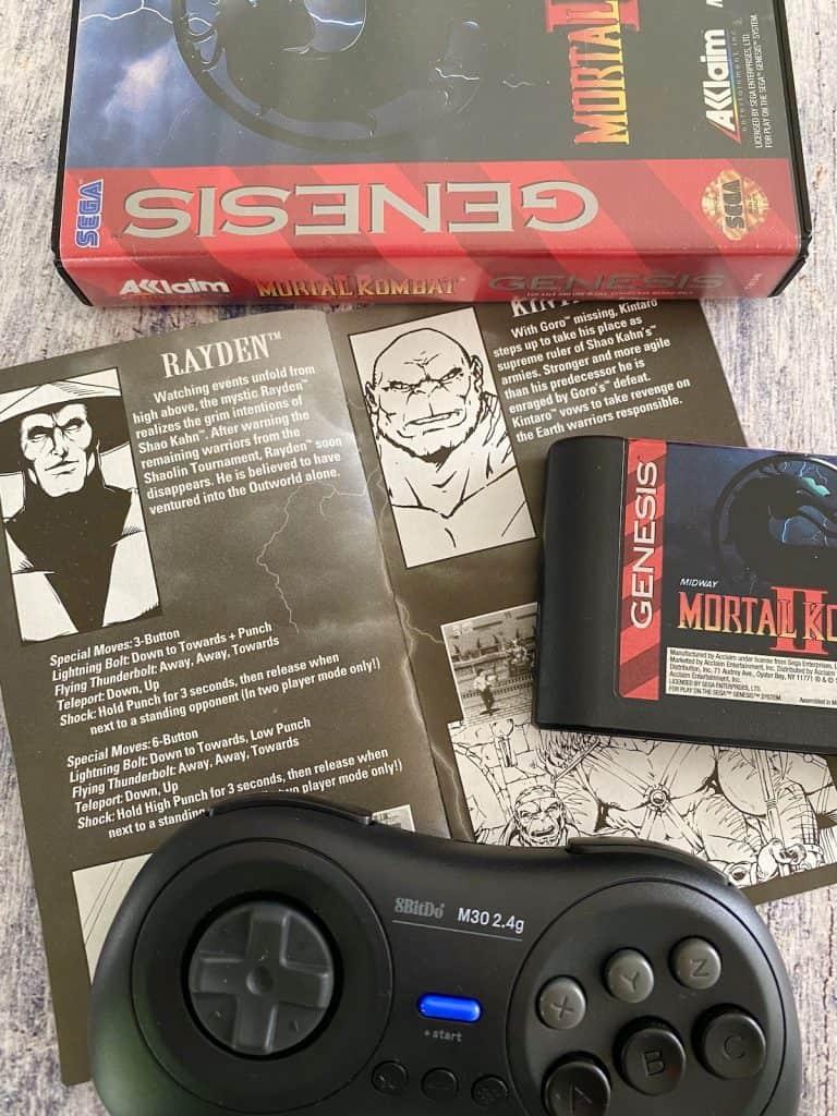 Mortal Kombat II Genesis box, cart, instruction manual pages, and 8bitdo Genesis controller