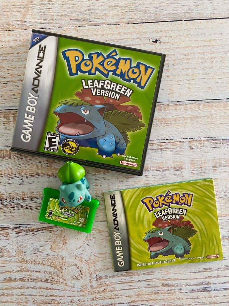 Pokemon LeafGreen box art, cart, manual, and Bulbasaur figure