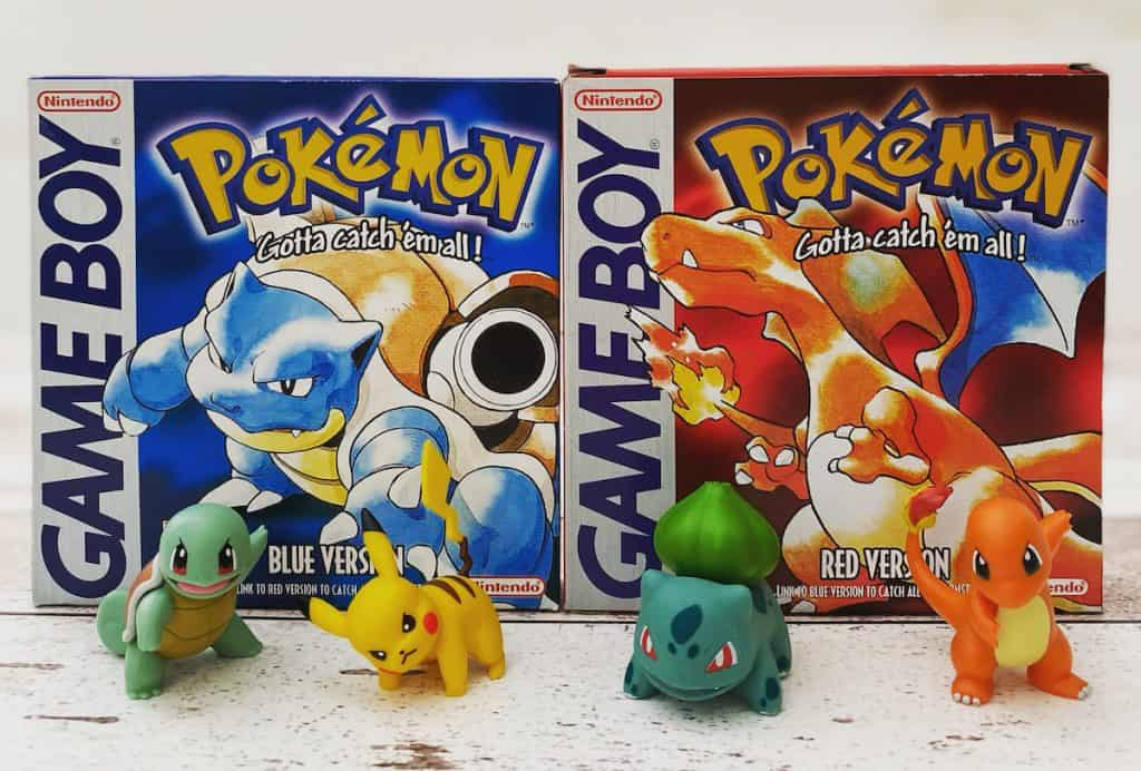 Pokemon Red and Pokemon Blue complete in box with Squirtle, Bulbasaur, Charmander, and Pikachu figures
