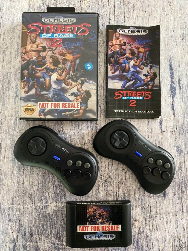 Streets of Rage 2 box, manual, cart, and 8bitdo Genesis controllers