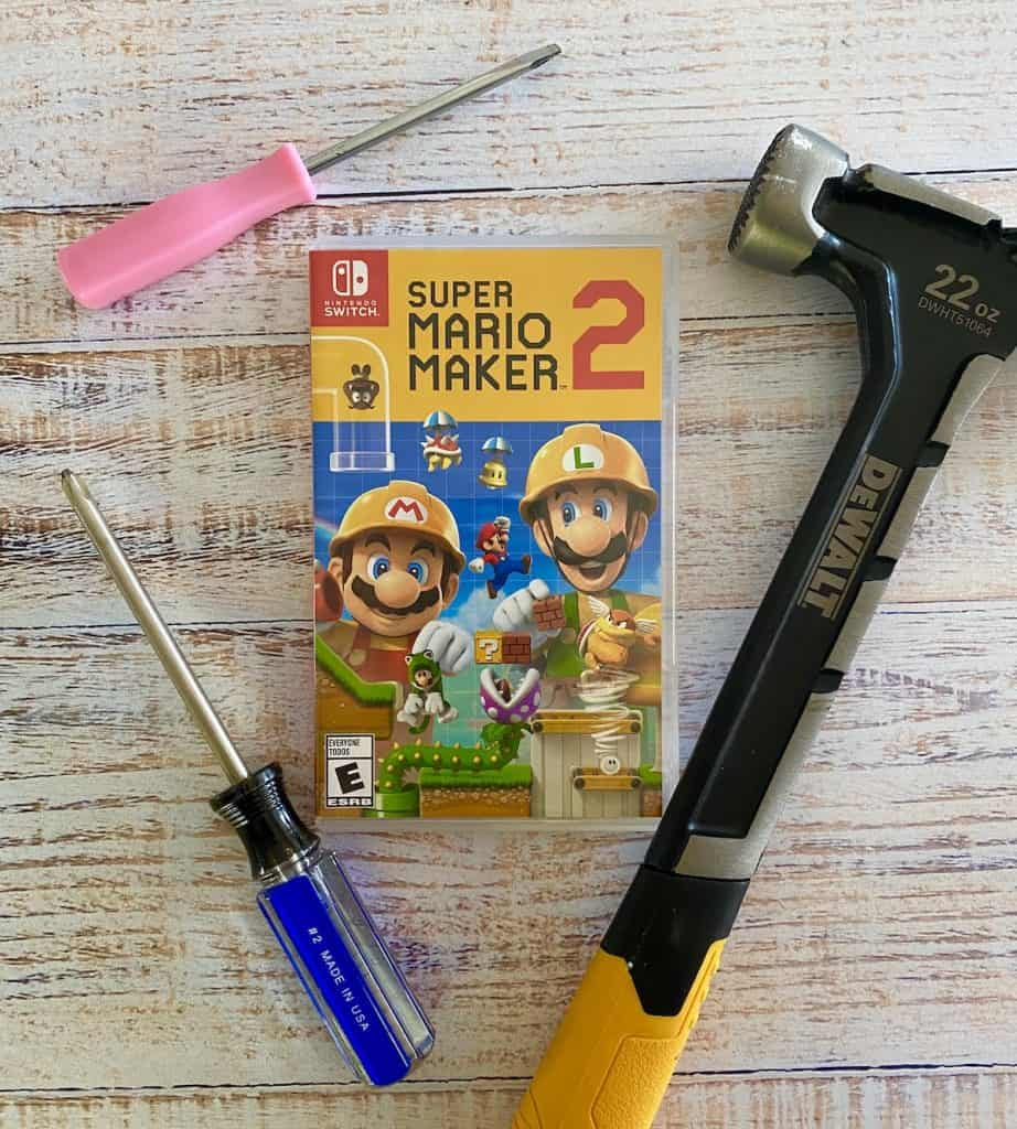 Super Mario Maker 2 with screwdrivers and hammer