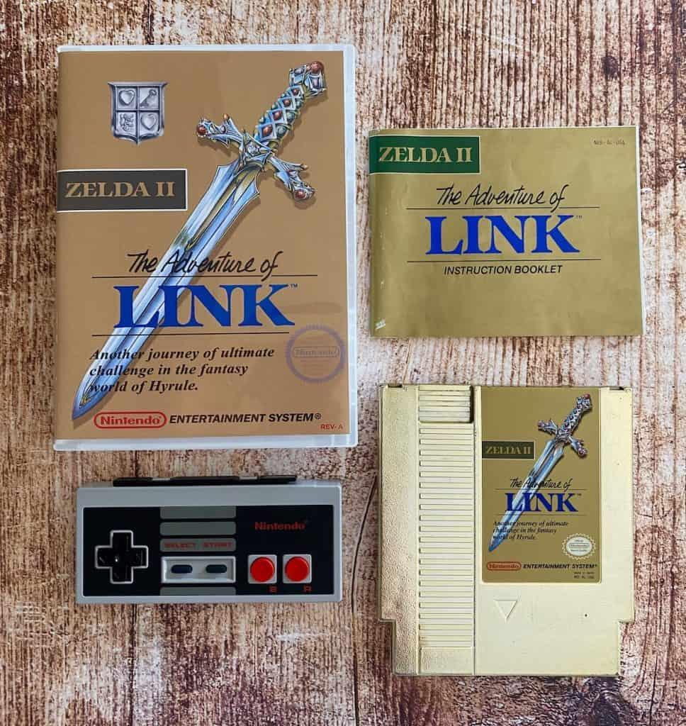 Zelda II: Adventure of Link case, manual, cart, and NES controller