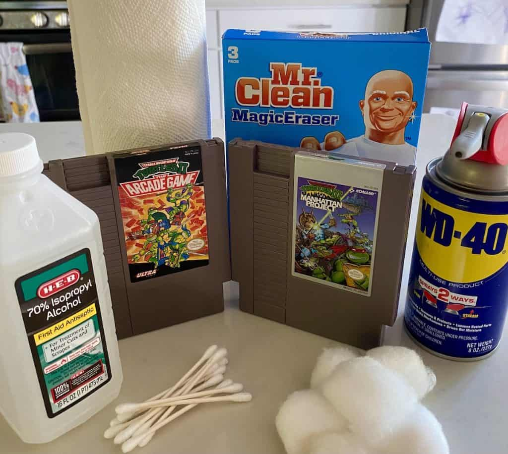 Game Cartridge cleaning supplies: paper towels, Q-tips, Mr. Clean Magic Erasers, WD-40, Alcohol, cotton balls