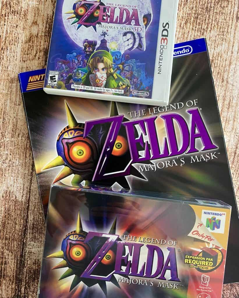 Zelda Majora's Mask N64 box, 3DS case, and Nintendo Power player's guide
