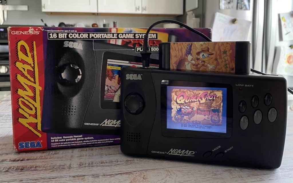 Sega Genesis Nomad and box, playing Quackshot