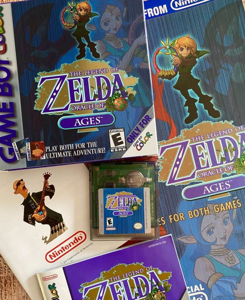 Zelda Oracle of Ages box, cart, manual, insert, and Nintendo Power player's guide