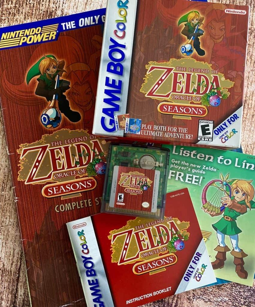 Zelda: Oracle of Seasons box, cart, manual, insert, and Nintendo Power Player's guide