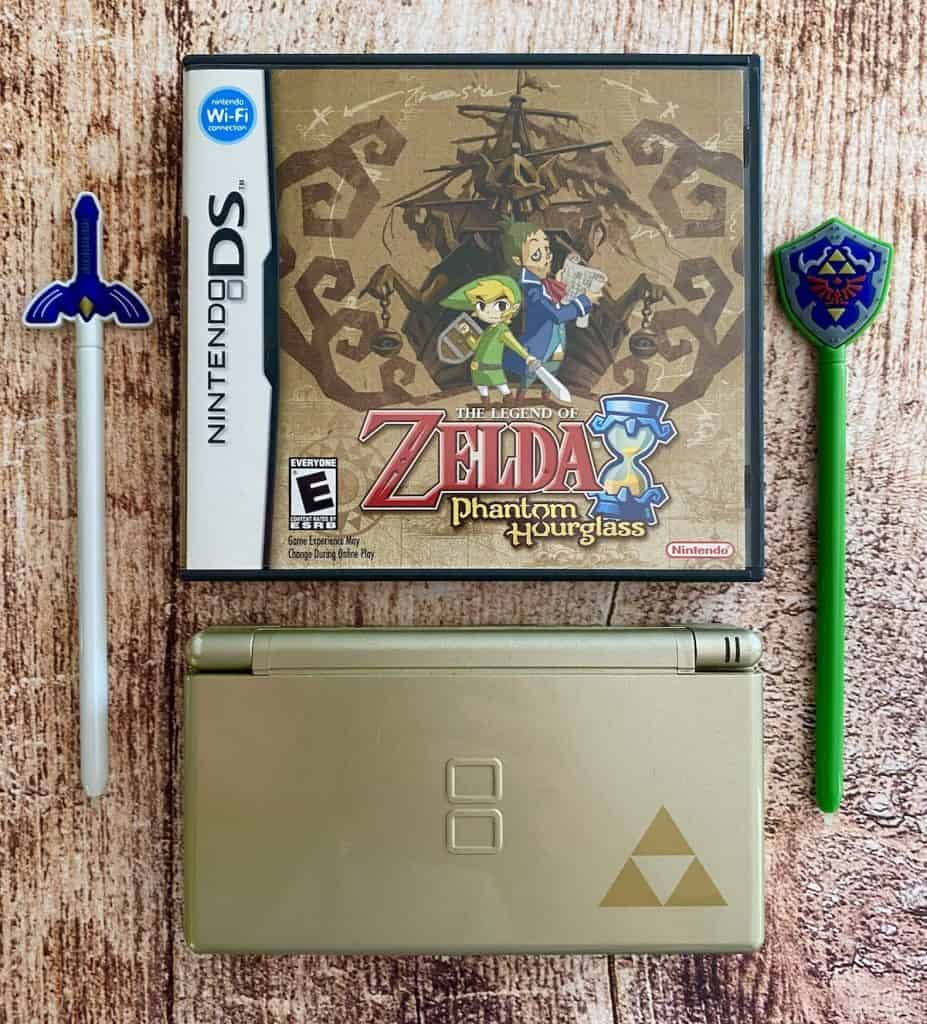 Zelda Phantom Hourglass case, special edition gold DS, and two Zelda-themed DS stylus