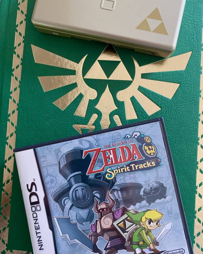 Zelda Spirit Tracks case, player's guide, and special edition gold DS