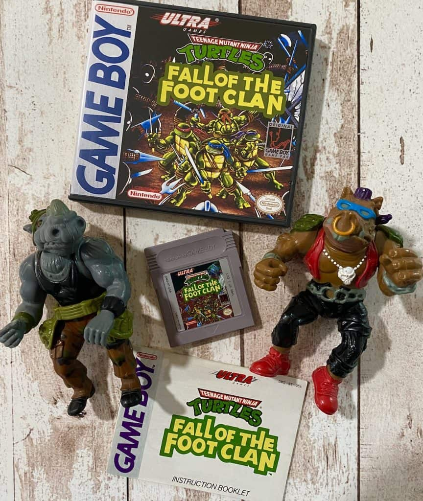 Turtles Fall of the Foot Clan Game Boy box, cart, and manual with Rocksteady and Bebop action figures