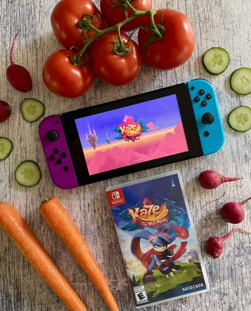 Kaze and the Wild Masks running on Switch, Switch case, and vegetables on the side