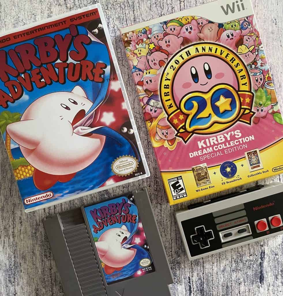 Kirby's Adventure NES box and cart, Kirby's Dream Collection for Wii, and NES controller