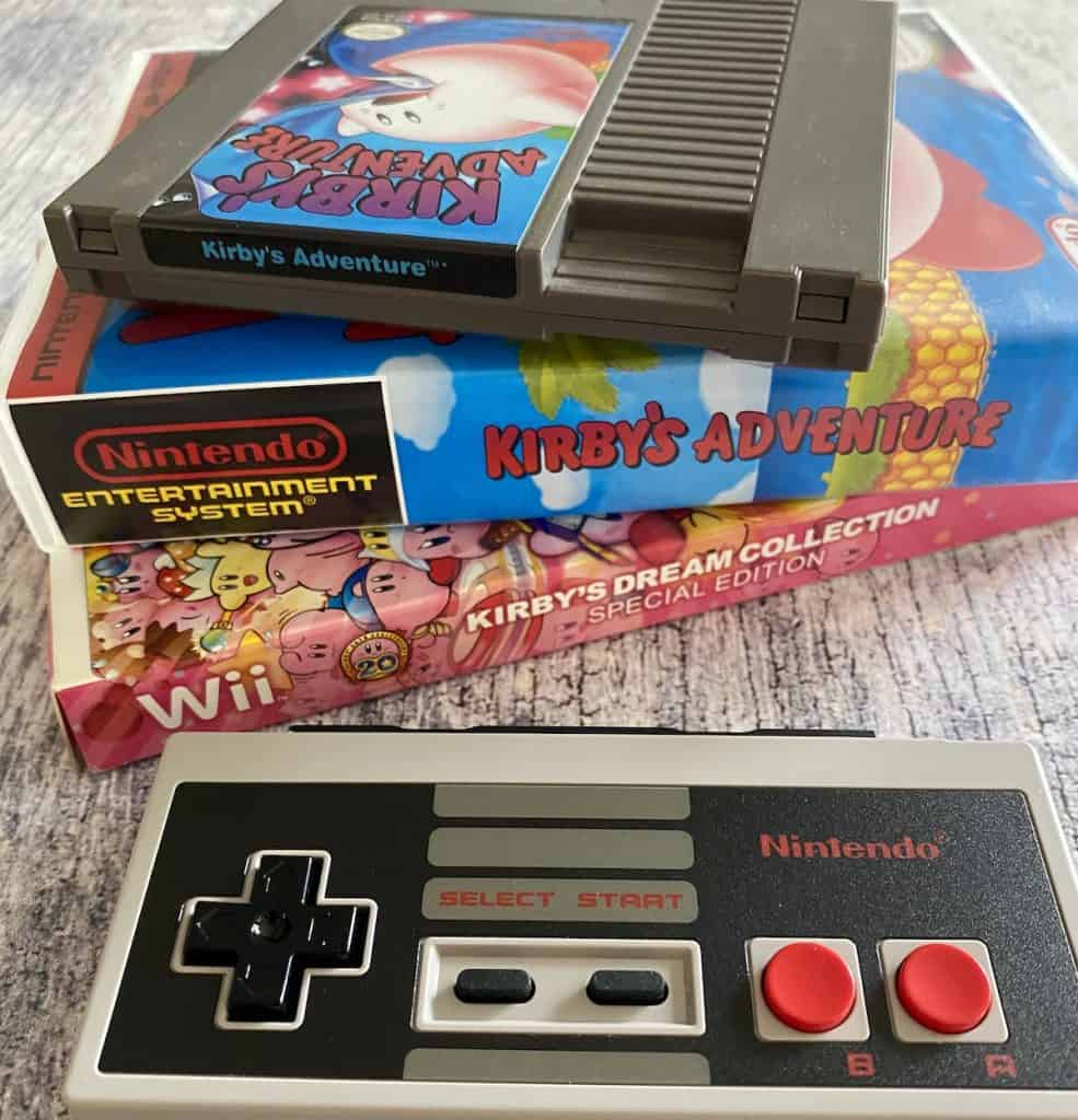 Kirby's Adventure NES cart, box, Kirby's Dream Collection for Wii, and NES controller