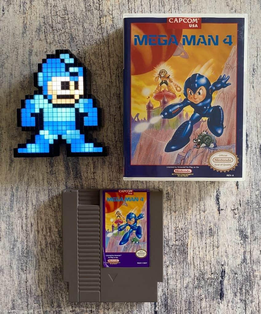 Mega Man 4 for NES box and cart, with Mega Man Pixel Pal