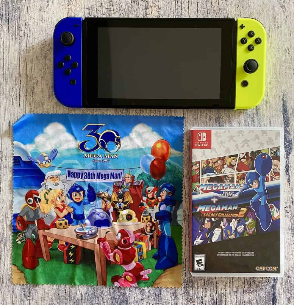 Mega Man Legacy Collection on Switch with cleaning cloth and Switch console