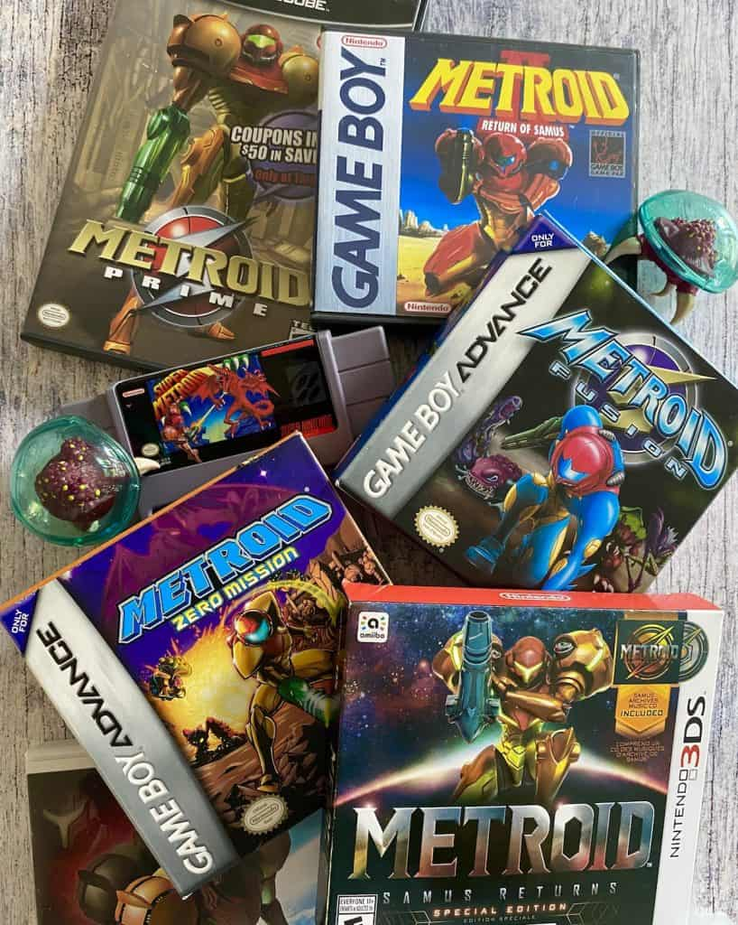 Collage of my favorite Metroid games: Prime, Metroid II, Samus Returns, Zero Mission, Fusion, and Super Metroid with two Metroid figures