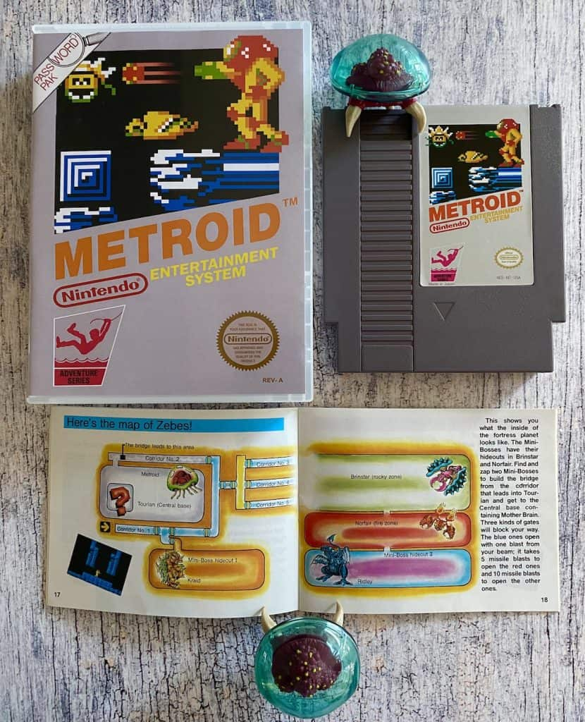 Metroid NES box, cart, manual, and two Metroid figures